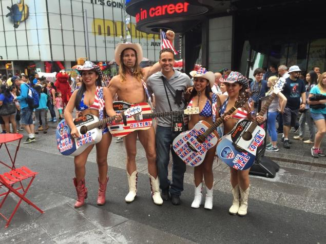 'There's so many boobs,' sighs The Naked Cowboy, Robert John Burck. 'You don't look at them anymore.'