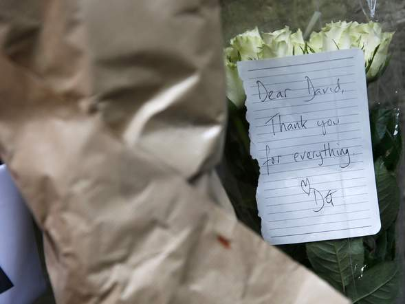 Bouquets and tributes lie outside the site of David Bowie's Ziggy Stardust album cover photoshoot in central London