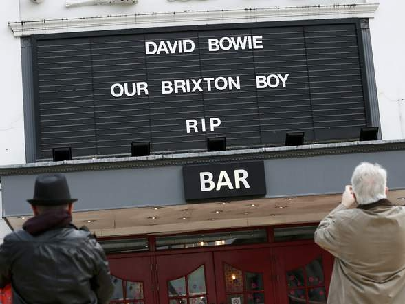 Bouquets lie outside the site of David Bowie's Ziggy Stardust album cover photoshoot in central London