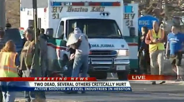 Two people hug after fleeing the shooting at Excel Industries in Hesston, Kansas.