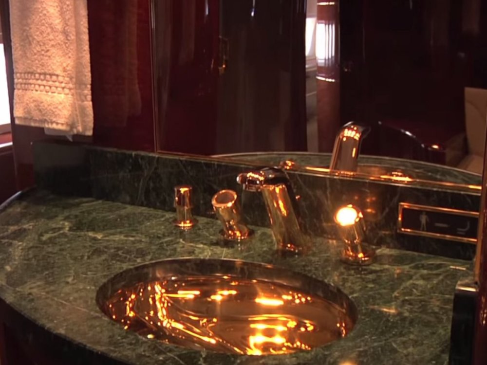 ... a master bath with 24-karat gold fixtures, and ...